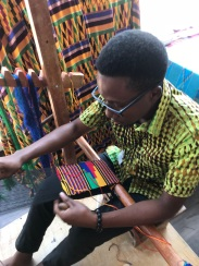 Kofi at the large Kente loom.